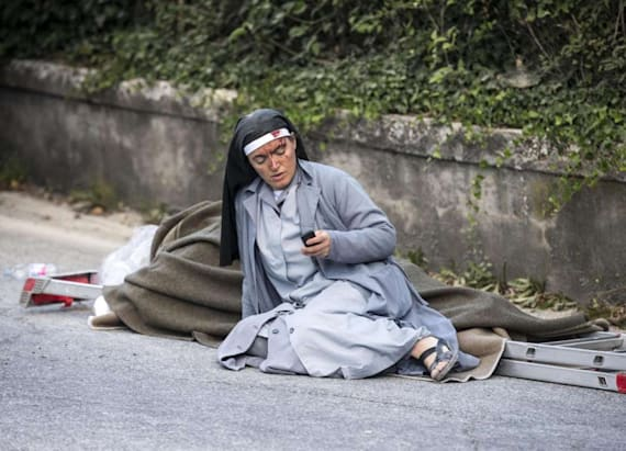 Nun in iconic quake photo texted friends 'adieu'