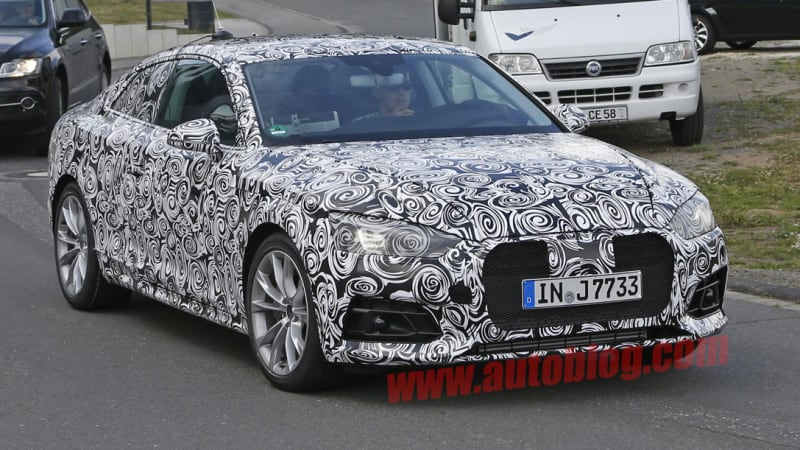 Next-gen Audi A5 shows its heavily camouflaged face