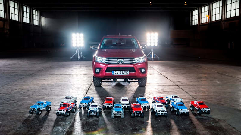 Watch these tiny radio-controlled Toyotas tow a full-size Hilux