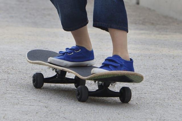 Boy riding skateboard on ramp