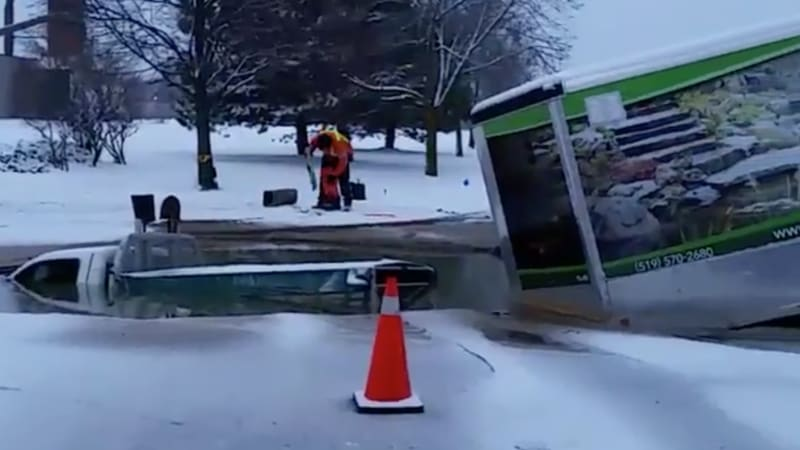 Pickup truck plunges into freezing sinkhole in Canada
