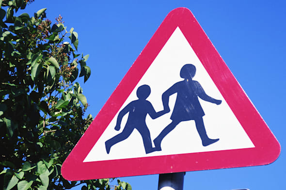 West Sussex,England - Warning: School children, education,color,vertical,West Sussex,England,warning,school,children,symbol,sign