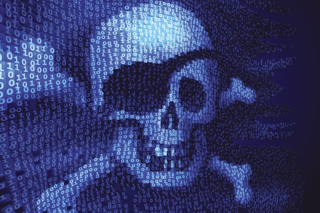 Skull and crossbones on binary code with message about hacking