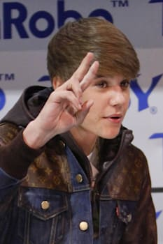 LAS VEGAS - JAN 11: Justin Bieber makes an appearance at the mRobo booth at the Consumer Electronics Show at The Las Vegas Conve