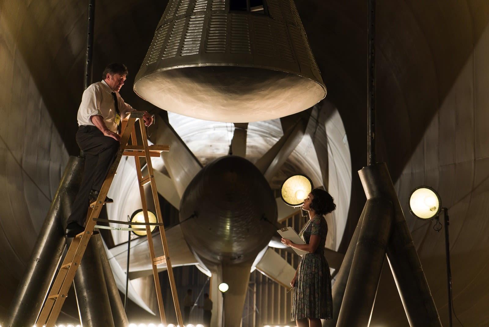 DF-00227_R - Mary Jackson (Janelle Monae) offers some help to NASA mission specialist Karl Zielinski (Olek Krupa). Photo Credit: Hopper Stone.