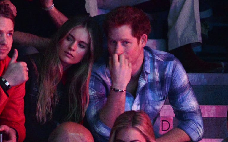 Prince Harry cozies up to girlfriend Cressida at his official engagement