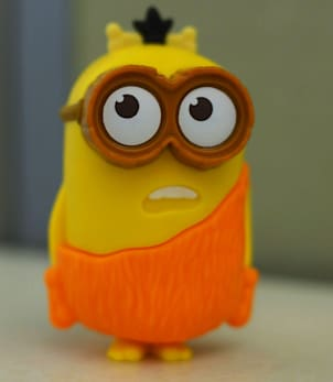 This Friday, July 10, 2015 photo shows a Minion toy in New York, distributed in McDonald's restaurant's Happy Meals. The company says the talking toy is speaking only nonsense words and not something a little more adult. Experts say McDonald's may be right, and the fault may lie in how our brains are primed to find words even when they're not really there. (AP Photo/Patrick Sison)