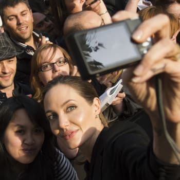 PARIS, FRANCE - JUNE 03:  Angelina Jolie takes a photo of herself with a fan's camera as she poses with fans upon her arrival for the Paris premiere of 'World War Z' at Cinema UGC Normandie on June 3, 2013 in Paris, France.  (Photo by Pascal Le Segretain/Getty Images For Paramount)
