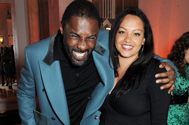 Idris Elba (L) and Naiyana Garth attend the Harper's Bazaar Women of the Year awards at Claridge's Hotel on November 5, 2013 in London