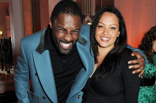 Idris Elba (L) and Naiyana Garth attend the Harper's Bazaar Women of the Year awards at Claridge's Hotel on November 5, 2013 in London