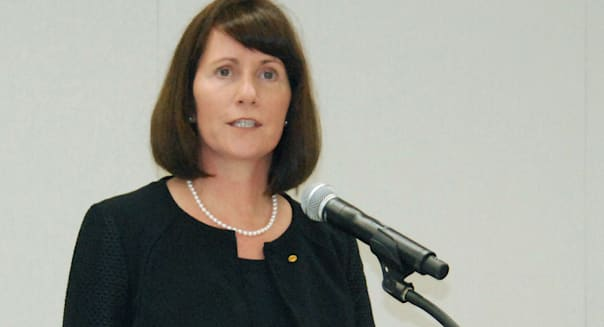 FILE - In this July 17, 2015 file photo, Toyota Motor Corp.'s head of public relations Julie Hamp speaks during a press conference in Toyota, central Japan.  Hamp, Toyota's most senior female executive, has resigned following her arrest in Japan on suspicion of drug law violations, the automaker said Wednesday, July 1, 2015. (Tsutomu Agechi/Kyodo News via AP, File) JAPAN OUT, CREDIT MANDATORY