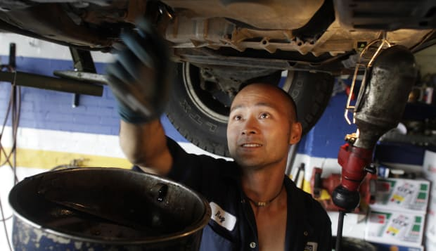 August 18, 2009 -Napa AutoPro store mechanic Roy Yu works on a car at the AutoPro shop at 1520 Warde