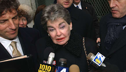 HELMSLEY SUED (Surrounded by her attorneys Jeffrey Taub, left, and Steven Eckhaus, right, Leona Helmsley speaks to the press out