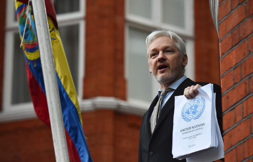 (FILES) This file photo taken on February 5, 2016 shows WikiLeaks founder Julian Assange addresses the media holding a printed report of the judgement of the UN's Working Group on Arbitrary Detention on his case from the balcony of the Ecuadorian embassy in central London.Swedish prosecutors investigating rape accusations against WikiLeaks founder Julian Assange must decide on May 19, 2017 if they will lift a European-wide arrest warrant against him in a seven-year case.  / AFP PHOTO / BEN STANSALL