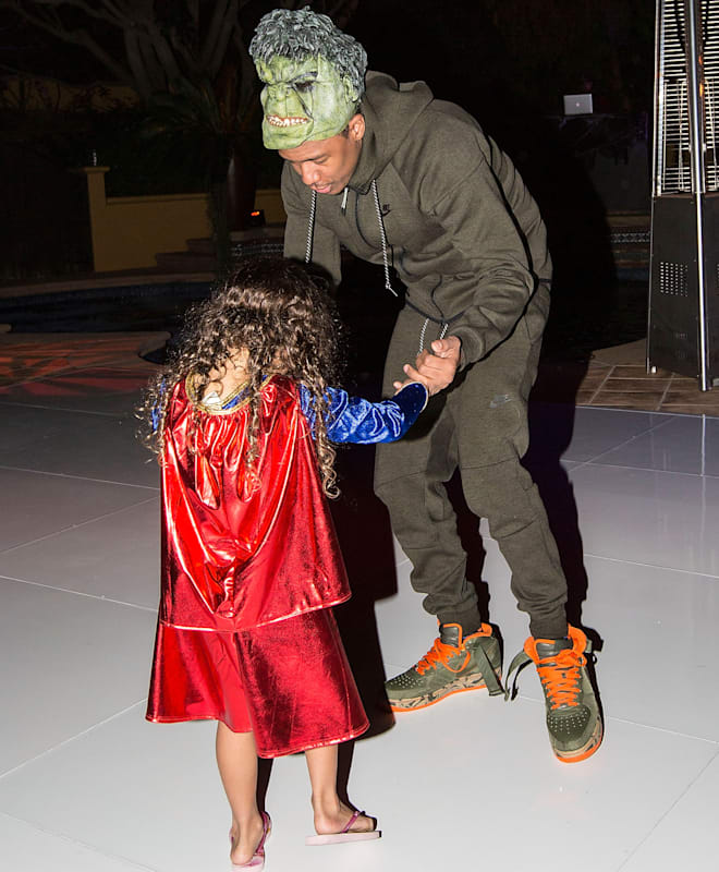 LOS ANGELES, CA - OCTOBER 31:  (EXCLUSIVE COVERAGE) Television personality Nick Cannon dances with his daughter Monroe Cannon at Mariah Carey's Festive Halloween Party at her Beverly Hills Airbnb home on October 31, 2015 in Los Angeles, California.  (Photo by FilmMagic/FilmMagic)