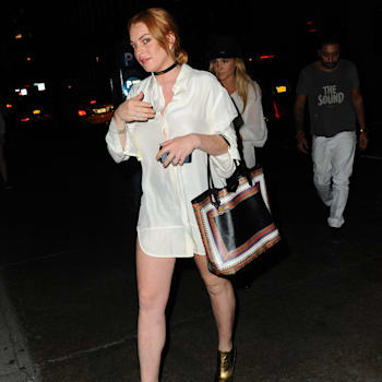 NEW YORK, NY - AUGUST 20:  Actress Lindsay Lohan, Jackie Swerz  and Vikram Chatwal is seen Soho  on August 20, 2013 in New York City.  (Photo by Raymond Hall/FilmMagic)