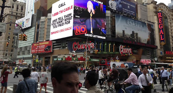 This image provided by CBS shows a CBS advertisement in Times Square in New York on Friday, Aug. 2, 2013. Three million Time Warner Cable customers in New York, Los Angeles and Dallas lost access to CBS programming in a fee dispute Friday, threatening their ability to watch popular shows like