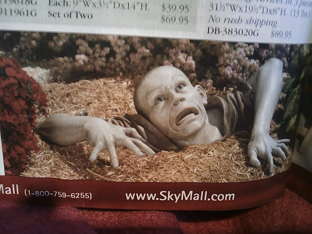 Creepy Zombie crawling out of the ground. Life-size. From SkyMall.com