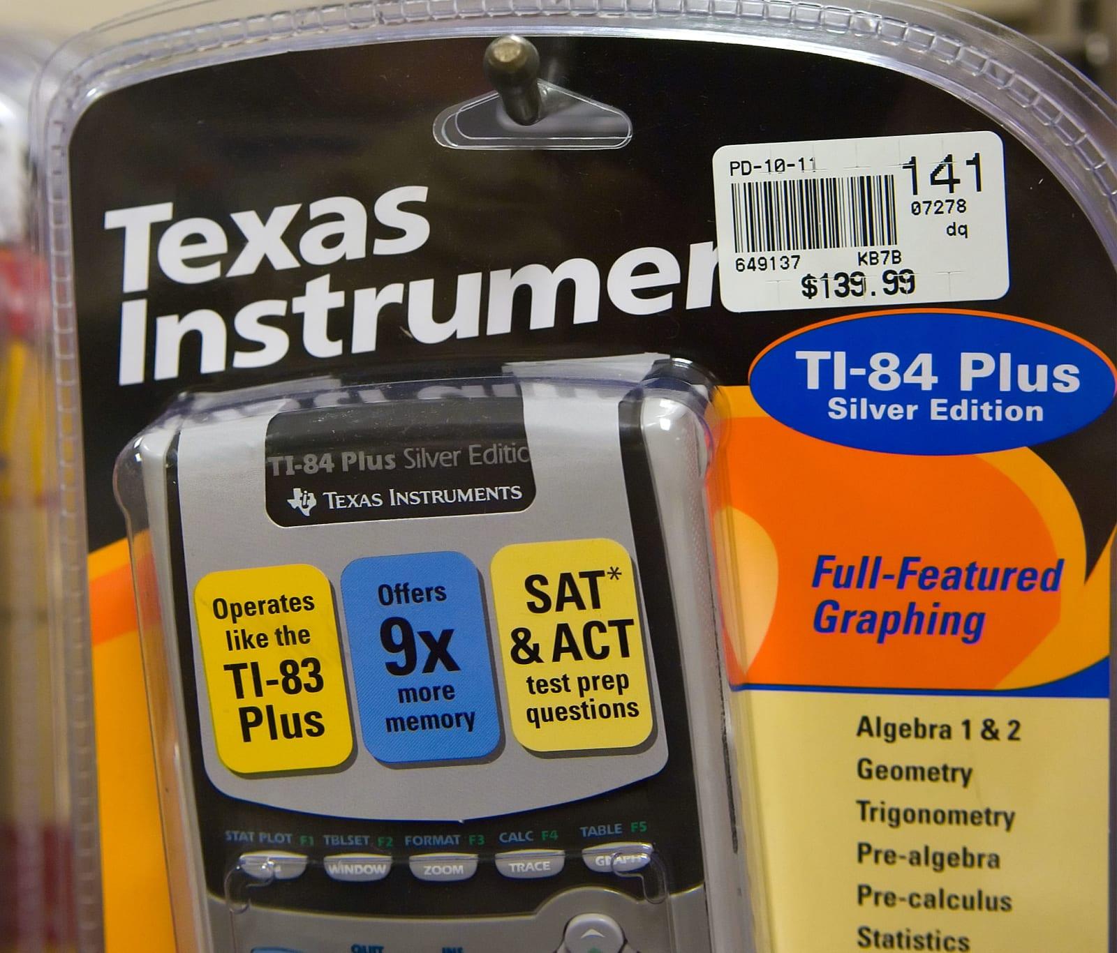 A Texas Instruments TI-84 calculator hangs on a display rack