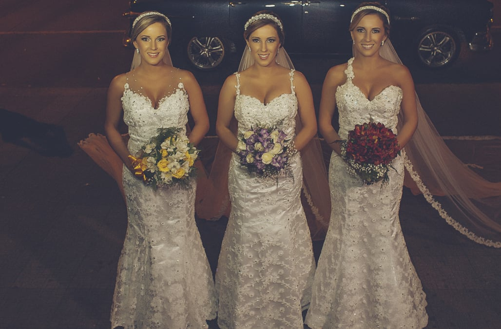 Identical triplets Radaela, Rochele and Tagiane from Passo Fundo, Brazil got married to their respective husbands in a joint wedding ceremony in a Catholic cathedral