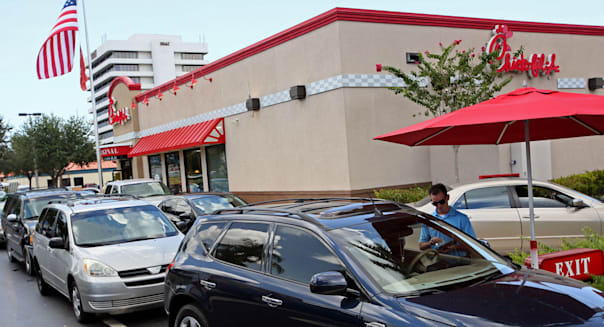 Aug. 1, 2012 - West Palm Beach, Florida, U.S. -   WEST PALM BEACH -  Chick-fil-A employee Brad Treen (cq) takes orders at a seco