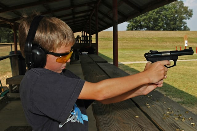 Boy using gun