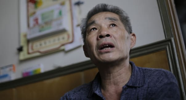 In this Sept. 9, 2013 photo, Dong Linhua, 59, speaks at his home in Shanghai. Dong, a former Shanghai factory worker and now a real estate investor who owns three apartments and two small shop spaces says,