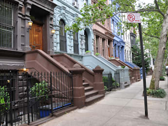 brownstone homes tree lined...