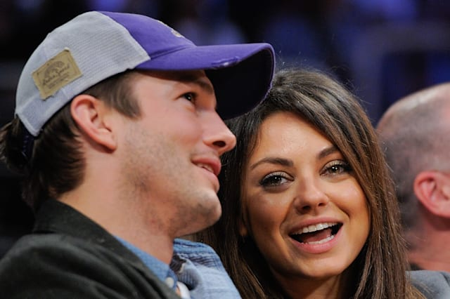 Ashton Kutcher (L) and Mila Kunis