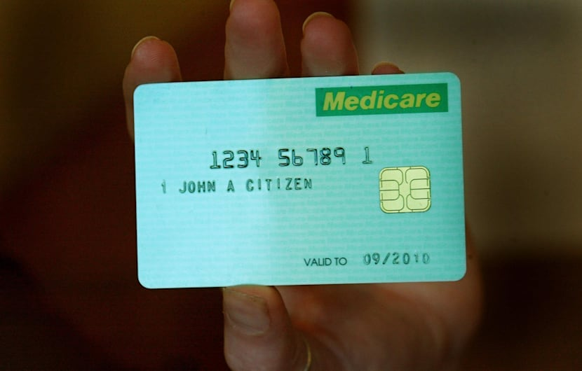 The new Medicare Smart card at Parliament House, 24 June 2004. SMH Picture by