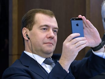 Russian Prime minister Dmitry Medvedev takes a picture of the Eiffel Tower with his smartphone during a meeting, on November 27, 2012, at French employers association MEDEF's headquarters in Paris. AFP PHOTO ERIC FEFERBERG        (Photo credit should read ERIC FEFERBERG/AFP/Getty Images)