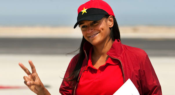 29 Jan 2013, Lobito, Angola --- epa03561008 A file photo dated 27 August 2012 shows Isabel dos Santos posing and making the V sign in Lobito, Angola, 29 January 2013. Isabel dos Santos, the oldest daughter of the Angolian President, is a business woman and investor, and, according to Forbes Magazine's recent calculations, she is Africa's first female billionaire. On top of her interests in oil and diamonds, she has significant shares in telecommunications, media, retail, finance and the energy industry, both in Angola and in Portugal. EPA/PAULO NOVAIS --- Image by ? PAULO NOVAIS/epa/Corbis