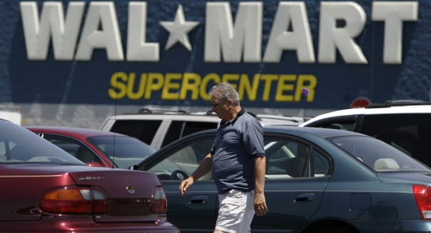 Retail Sales (A customer walks to his car in the parking lot of a WAL-MART Supercenter in Mechanicsburg, Pa., Thursday, June 12,