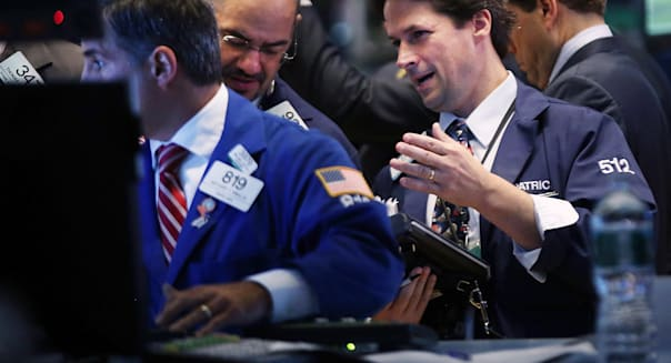 new york stock exchange traders investing stocks wall street earnings