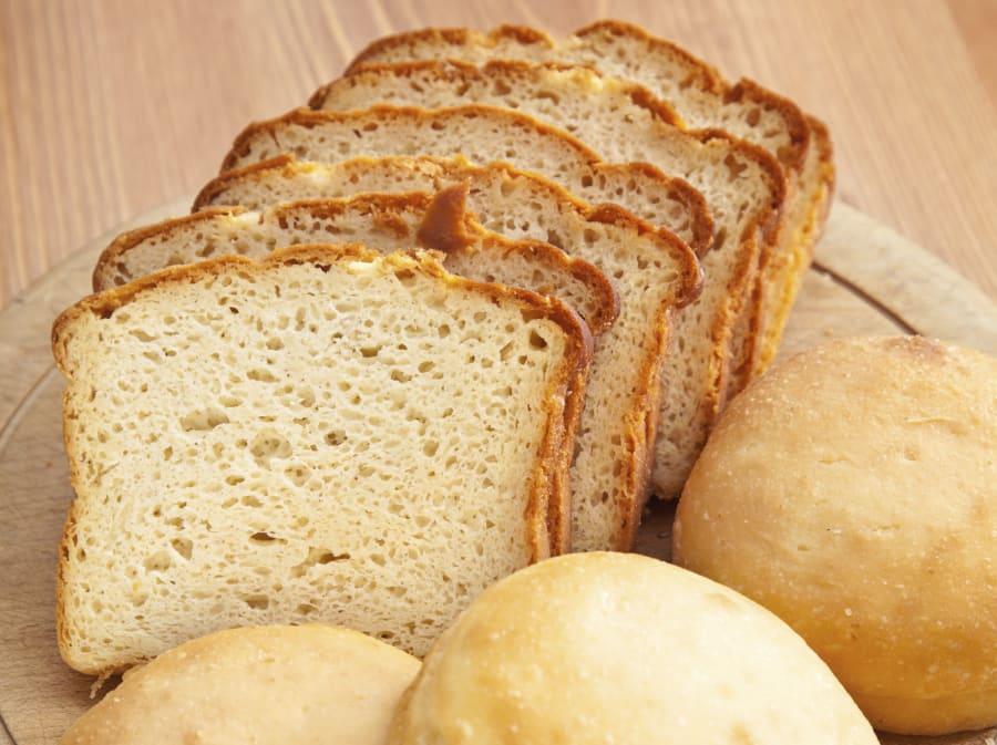 Gluten free sliced sandwich bread and hamburger buns.  Shallow dof