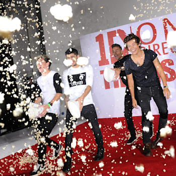 LONDON, UNITED KINGDOM - AUGUST 19: Louis Tamlinson, Zayn Malik, Niall Horan, Liam Payne, Harry Styles and Morgan Spurlock of One Direction attend a photocall to launch their new film 'one Direction: This Is Us 3D' on August 19, 2013 in London, England. (Photo by Stuart C. Wilson/Getty Images)
