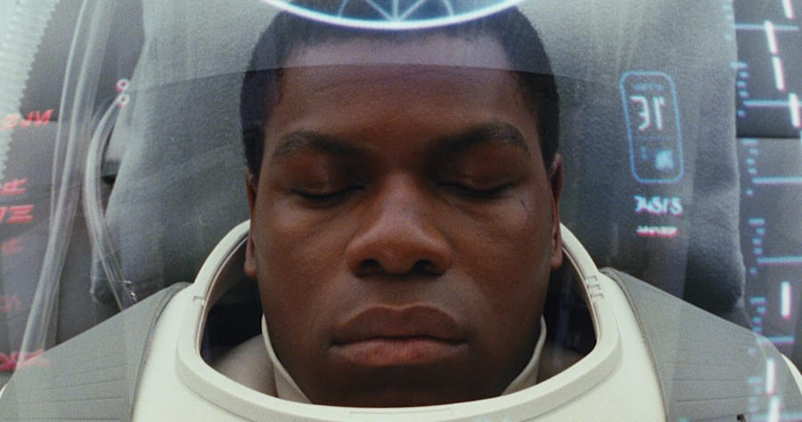 """This image released by Lucasfilm shows John Boyega as Finn in a scene from the upcoming """"Star Wars: The Last Jedi,"""" expected in theaters in December. (Industrial Light & Magic/Lucasfilm via AP)"""