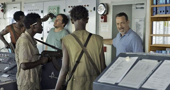 CAPTAIN PHILLIPS 2013 Columbia Pictures film with Tom Hanks at right
