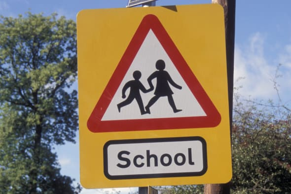 Schoolchildren road safety road sign with solar panel, Yorkshire
