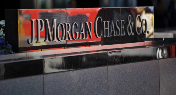 The JPMorgan Chase & Co. logo is displayed at the company's offices in New York, U.S., on Friday, May 17, 2013. As JPMorgan Chase & Co.?s Jamie Dimon prepares for a vote tomorrow on whether he should keep his chairman and chief executive officer titles, he may take comfort knowing most of his biggest shareholders are led by men with the same dual role. Photographer: Victor J. Blue/Bloomberg via Getty Images
