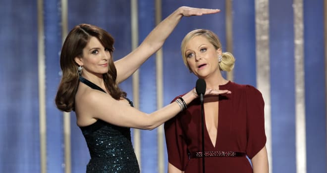 70th Golden Globe Awards - Show (This image released by NBC shows co-hosts Tina Fey, left, and Amy Poehler on stage during the 7