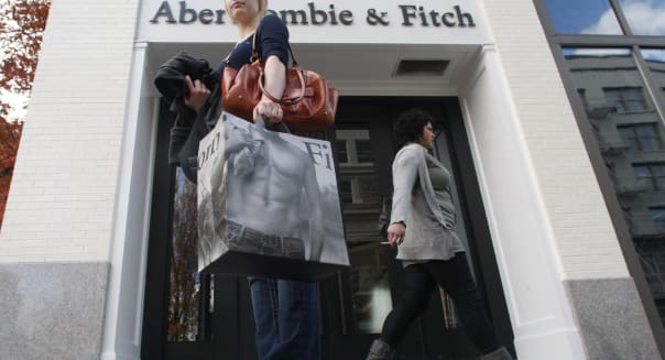 In this photo made Wednesday, Nov. 11, 2009, a shopper holds a shopping bag in front of an Abercrombie & Fitch store in Portland, Ore. Preppy clothing seller Abercrombie & Fitch Co.'s third-quarter profit fell 39 percent as sales continued to be weak and the company worked to close its higher-priced Reuhl line, the company said Friday, Nov. 13, 2009. (AP Photo/Rick Bowmer)