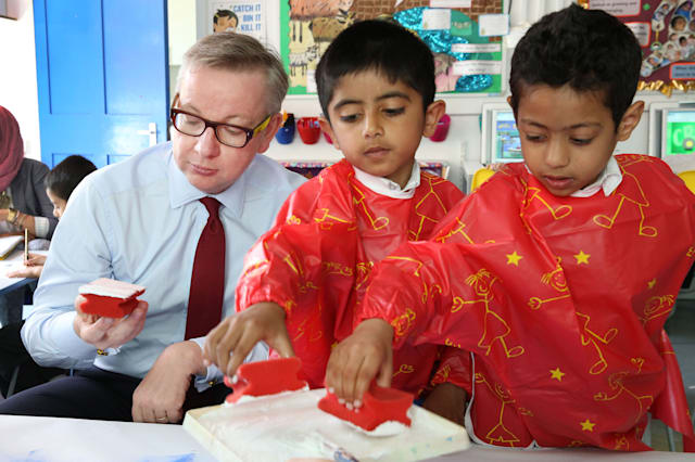 Education Secretary Michael Gove looks confused by a paint sponge