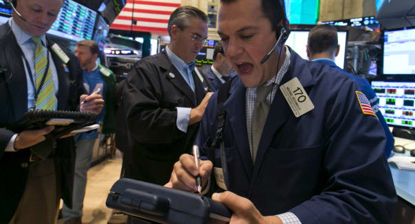 Wall Street (Trader Michael Zicchinolfi, right, works on the floor of the New York Stock Exchange, Friday, Oct. 25, 2013. Earnin