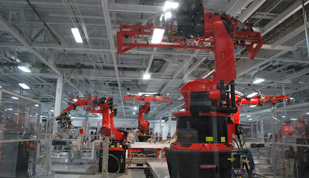 Robots in the Tesla Factory manufacturing line