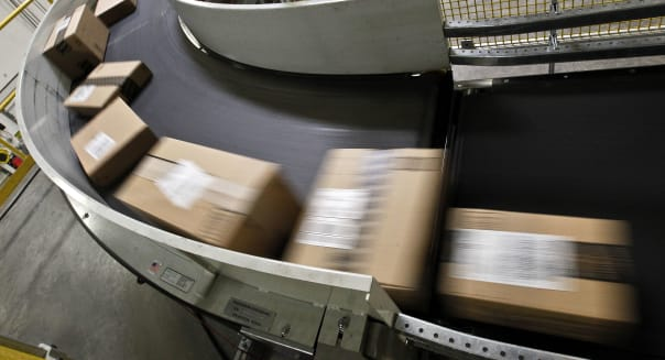 Cyber Monday (Packages ready to ship move along a conveyor belt at the Amazon.com 1.2 million square foot fulfillment center Mon