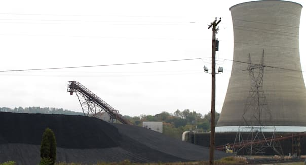 In this Oct. 14, 2013 photo, tons of coal sit next to a Big Sandy power plant unit near Louisa, Ky., but the days of using coal to generate electricity are numbered at the sprawling operation in eastern Kentucky. Kentucky Power Co. is closing the complex?s 800-megawatt unit in 2015, and the utility says it will seek regulatory approval to convert the plant?s smaller unit to burn natural gas instead of coal. (AP Photo/Bruce Schreiner)
