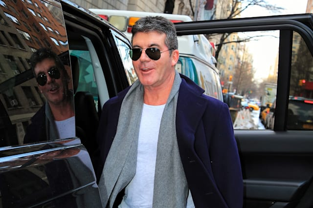 Simon Cowell arrives for son's birth