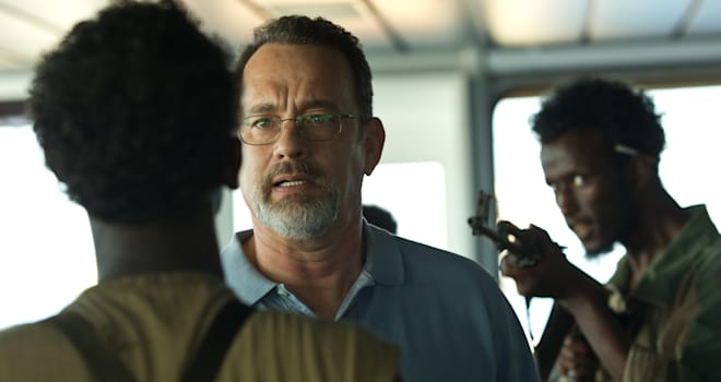 Film Review Captain Phillips (This film image released by Sony - Columbia Pictures shows Tom Hanks, center, in a scene from