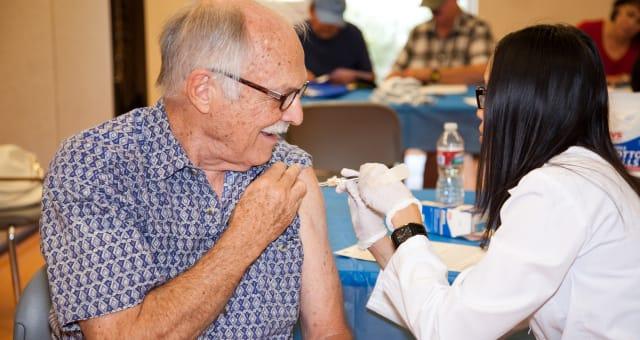 Sanofi Pasteur - Tucson, AZ (IMAGE DISTRIBUTED FOR NATIONAL COUNCIL ON AGING AND SANOFI PASTEUR - Pharmacist Jill Ruth Nguyen, r